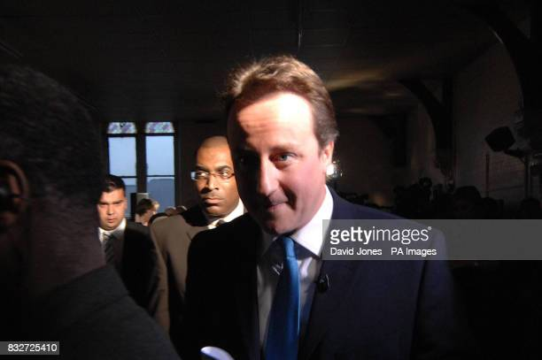 Conservative party leader David Cameron with Rev Derek Webley of the New Testament Church of God in Lozells Birmingham