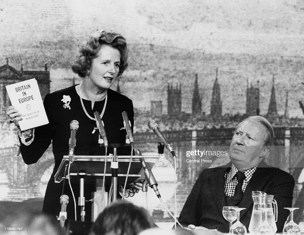 Conservative Party Leader of the Opposition, <a gi-track='captionPersonalityLinkClicked' href=/galleries/search?phrase=Margaret+Thatcher&family=editorial&specificpeople=159677 ng-click='$event.stopPropagation()'>Margaret Thatcher</a> speaking at a meeting of the party's campaign to keep Britain in the Common Market, watched by her predecessor <a gi-track='captionPersonalityLinkClicked' href=/galleries/search?phrase=Edward+Heath&family=editorial&specificpeople=158692 ng-click='$event.stopPropagation()'>Edward Heath</a> (1916 - 2005), 17th May 1975. Thatcher is holding up a publication entitled 'Britain In Europe, The Benefits Of Membership'.