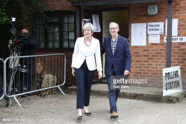 Conservative Party leader Theresa May and husband Philip arrive at a polling station to vote on June 8 2017 in Maidenhead England Polling stations...