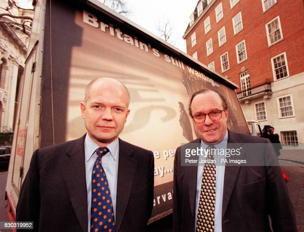 Conservative Party leader William Hague with party chairman Michael Ancram outside Conservative Central Office for the launch of the latest poster as...