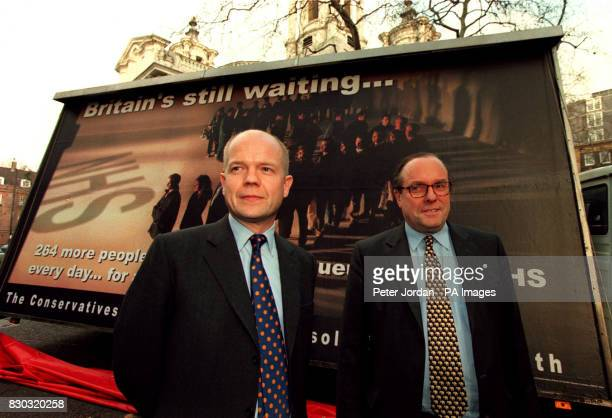 Conservative Party leader William Hague with party chairman Michael Ancram outside Conservative Central Office for the launch of the latest poster...