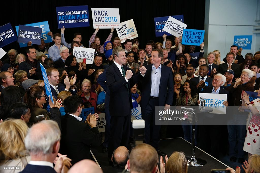Conservative Party London Mayoral candidate Zac Goldsmith (L), current London Mayor Boris Johnson (C obscured) and Britain's Prime Minister David Cameron (R) attend a campaign event in Richmond, southwest London, on May 3, 2016. / AFP / ADRIAN
