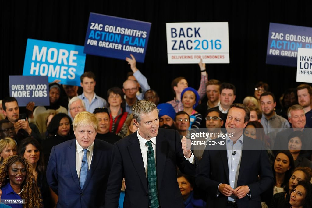 Conservative Party London Mayoral candidate Zac Goldsmith (C) speaks as current London Mayor Boris Johnson (L) and Britain's Prime Minister David Cameron (R) stand by at a campaign event in Richmond, southwest London, on May 3, 2016. / AFP / ADRIAN