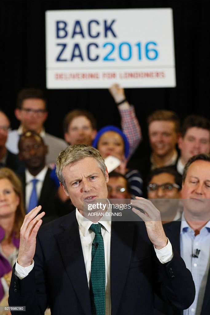 Conservative Party London Mayoral candidate Zac Goldsmith speaks as Britain's Prime Minister David Cameron (R) stands by at a campaign event in Richmond, southwest London, on May 3, 2016. / AFP / ADRIAN