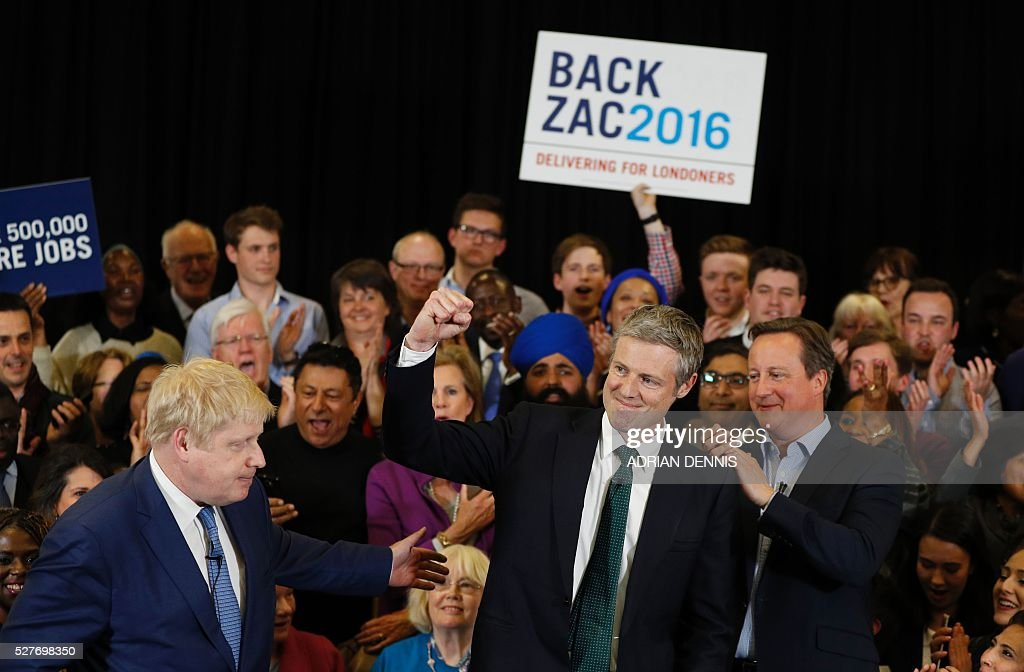 Conservative Party London Mayoral candidate Zac Goldsmith speaks as Britain's Prime Minister David Cameron (R) and current London Mayor Boris Johnson (L) stand by at a campaign event in Richmond, southwest London, on May 3, 2016. / AFP / ADRIAN