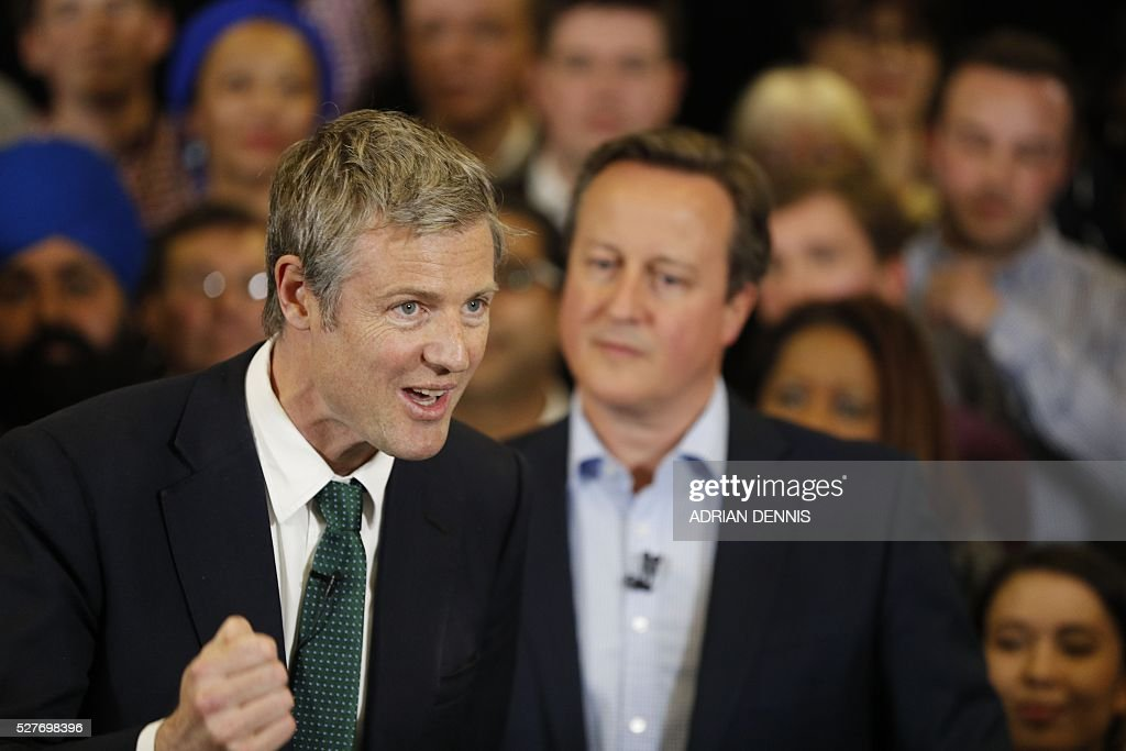 Conservative Party London Mayoral candidate Zac Goldsmith (L) speaks as Britain's Prime Minister David Cameron (R) stands by at a campaign event in Richmond, southwest London, on May 3, 2016. / AFP / ADRIAN