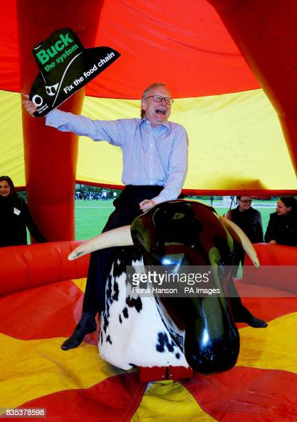 Conservative Party MP John Gummer rides a mechanical bull in support of Friends of the Earth's planet friendly farming campaign in Victoria Tower...