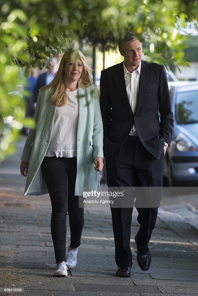 Conservative Party MP Zac Goldsmith (R) and his wife Alice Goldsmith (L) walk towards to the polling station to cast their votes within London Mayoral Elections in Richmond Park constituency in London, United Kingdom on May 05, 2016.