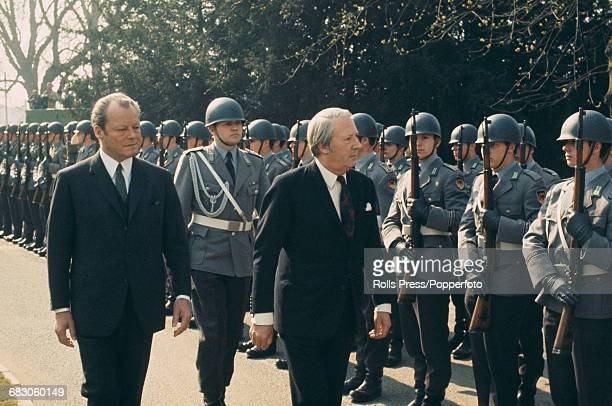Conservative Party politician and Prime Minister of the United Kingdom Edward Heath pictured right with Chancellor of West Germany Willy Brandt as...