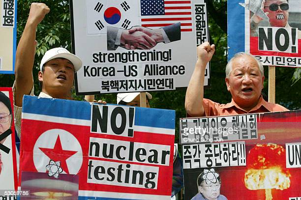 Conservative protesters carry antiNorth Korean placards during an antiNorth Korea rally on June 13 2005 in Seoul South Korea US President George W...
