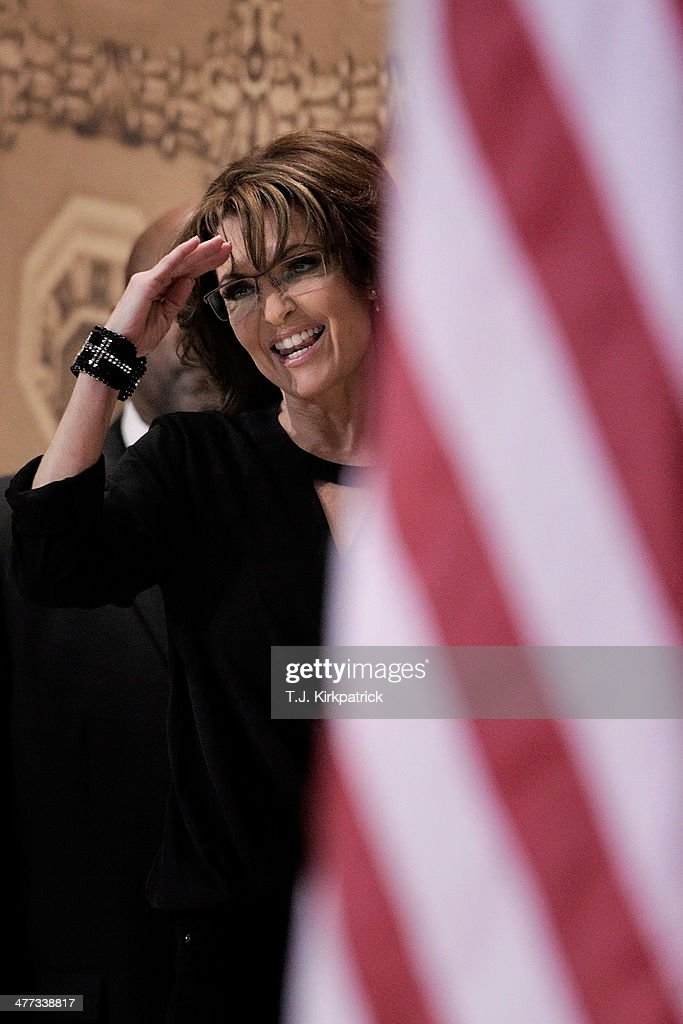 Conservative pundit, television personality and former vice presidential candidate <a gi-track='captionPersonalityLinkClicked' href=/galleries/search?phrase=Sarah+Palin&family=editorial&specificpeople=4170348 ng-click='$event.stopPropagation()'>Sarah Palin</a> gives a salute as she leaves the stage during the 41st annual Conservative Political Action Conference at the Gaylord International Hotel and Conference Center on March 8, 2014 in National Harbor, Maryland. The conference, a project of the American Conservative Union, brings together conservative polticians, pundits and voters for three days of speeches and workshops.