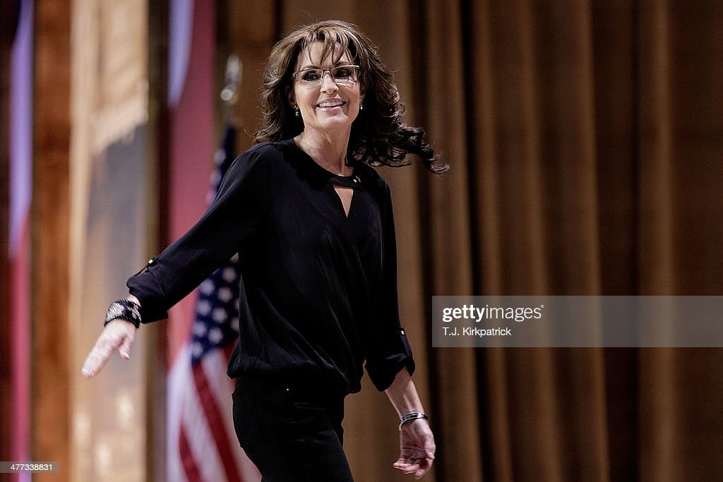 Conservative pundit, television personality and former vice presidential candidate <a gi-track='captionPersonalityLinkClicked' href=/galleries/search?phrase=Sarah+Palin&family=editorial&specificpeople=4170348 ng-click='$event.stopPropagation()'>Sarah Palin</a> waves as she leaves the stage during the 41st annual Conservative Political Action Conference at the Gaylord International Hotel and Conference Center on March 8, 2014 in National Harbor, Maryland. The conference, a project of the American Conservative Union, brings together conservative polticians, pundits and voters for three days of speeches and workshops.