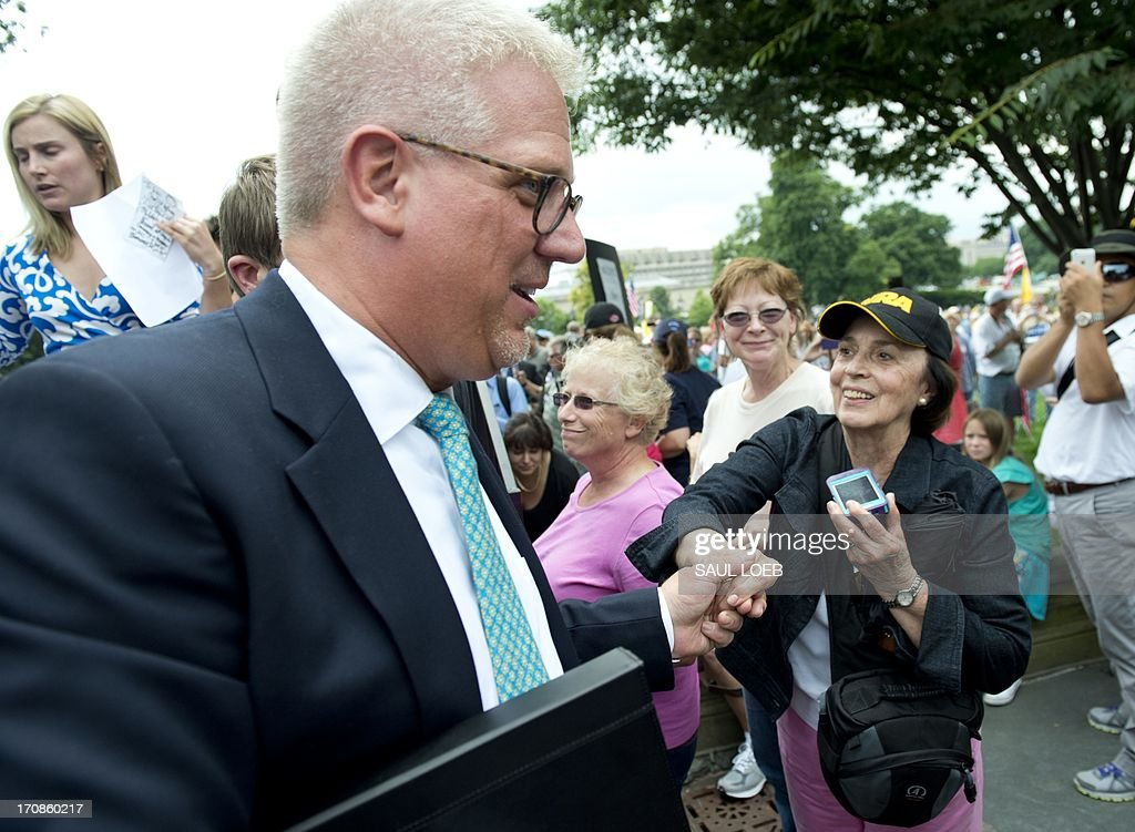 Conservative radio and television commentator Glenn Beck greets demonstrators with the Tea Party after speaking during a protest against the Internal Revenue Service (IRS) targeting of the Tea Party and similar groups during a rally called 'Audit the IRS' outside the US Capitol in Washington, DC, June 19, 2013. AFP PHOTO / Saul LOEB