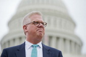 Conservative talk show host Glenn Beck attends a Tea Party Patriots rally on the west front of the Capitol to protest the IRS's targeting of...