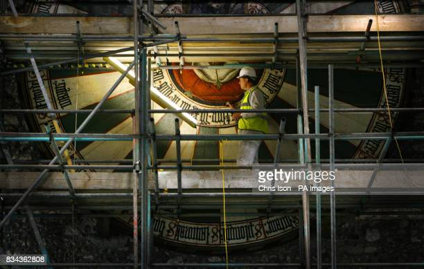 Conservator Peter Austen carries out the finishing touches of his restoration of King Arthur's famous Round Table in Winchester's Great Hall Over the...