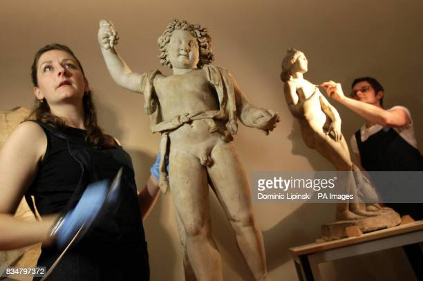 Conservators Amy Drago and Tracey Sweek work to conserve marble states of Bacchus and Aphrodite as part of the Conservation in Focus exhibition at...
