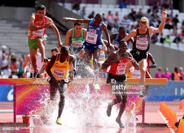 Conseslus Kipruto of Kenya and Boniface Sikowo of Uganda lead the competes in the Men's 3000 metres steaplchase during day three of the 16th IAAF...