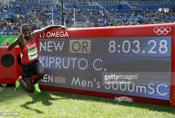 Conseslus Kipruto of Kenya celebrates after winning the Men's 3000m Steeplechase Final with a new Olympic record of 80328 on Day 12 of the Rio 2016...