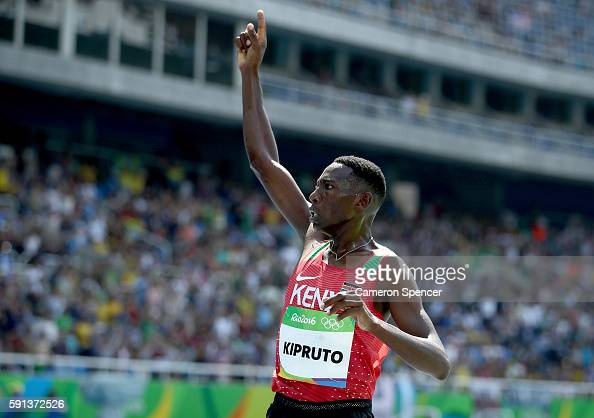 Conseslus Kipruto of Kenya celebrates winning the gold medal in the Men's 3000m Steeplechase Final on Day 12 of the Rio 2016 Olympic Games at the...