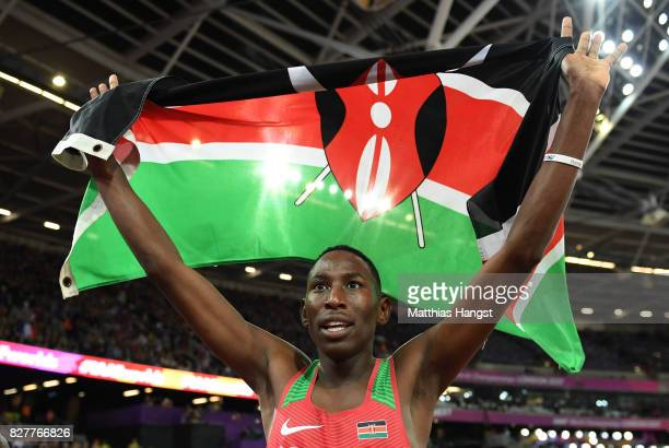 Conseslus Kipruto of Kenya celebrates with the Kenyan flag after winning the Men's 3000 metres Steeplechase final during day five of the 16th IAAF...