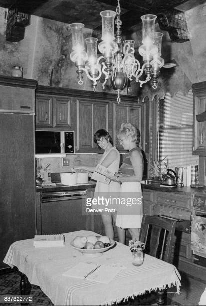 Considering the ingredients in recipe for 'Timbale Turkey' to be served at alumnoe brunch of Alpha Omicron Pi are Miss Morgot Griffith left and Mrs...