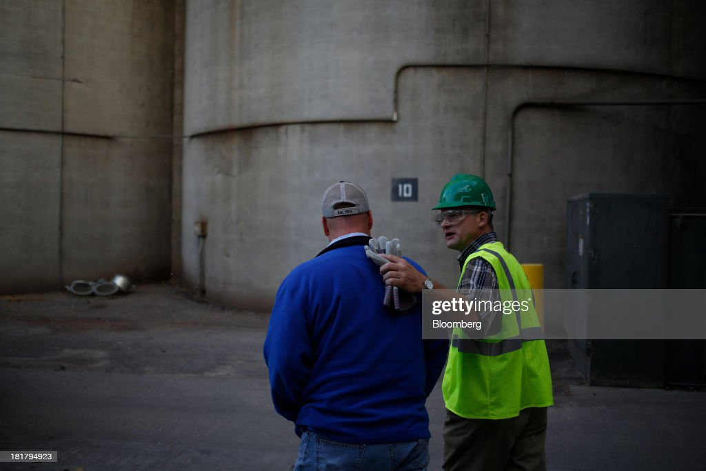 A Consolidated Grain & Barge Co. employee, right, talks to farmer Ray Tucker for after delivering a truckload of harvested corn at the company's facility in Jeffersonville, Indiana, U.S., on Tuesday, Sept. 24, 2013. Private exporters reported to the U.S. Department of Agriculture (USDA) export sales of 197,200 metric tons of corn for delivery to Mexico during the 2013 and 2014 marketing year. Photographer: Luke Sharrett/Bloomberg via Getty Images