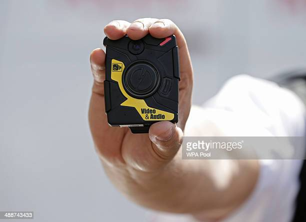 Constable Yasa Amerat holding a bodyworn video camera ahead of a yearlong pilot scheme by the Metropolitan police at Kentish Town on May 6 2014 in...