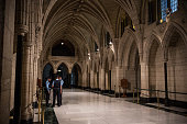 Constables guard the Hall of Honor in the Canadian Parliament one day after a gunmen infiltrated the building before being shot dead on October 23...
