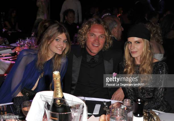 Constance Jablonksi creative director of Emilio Pucci Peter Dundas and Eugenie Niarchos arrive at amfAR's Cinema Against AIDS 2010 benefit gala at...