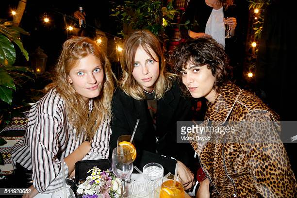 Constance Jablonski Edie Campbell and Mica Arganaraz attend Isabel Marant X mytheresa at Hotel Particulier Montmartre on July 4 2016 in Paris France