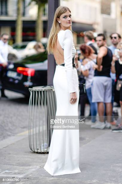 Constance Jablonski wears a white dress outside the Vogue Foundation Dinner during Paris Fashion Week Haute Couture Fall/Winter 20172018 on July 4...