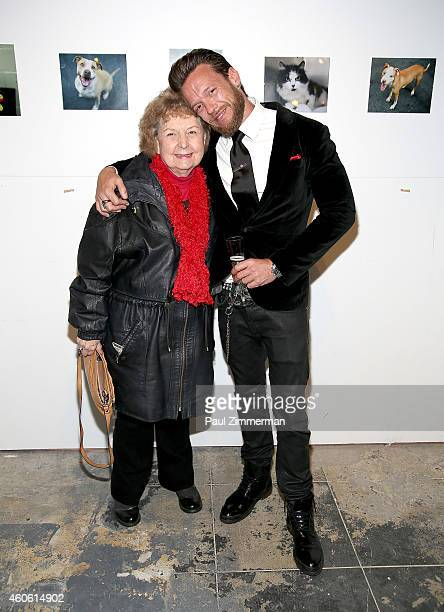 Constance McMullan and photographer Jamie McCarthy attend a pet portrait exhibition by Getty Images staff photographer Jamie McCarthy to benefit...