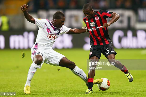 Constant Djakpa of Frankfurt is challenged by Abdou Traore of Bordeaux during the UEFA Europa League Group F match between Eintracht Frankfurt and FC...