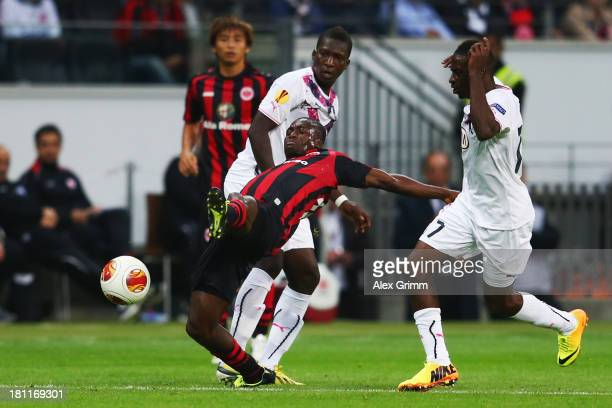 Constant Djakpa of Frankfurt is challenged by Andre Biyogo Poko and Abdou Traore of Bordeaux during the UEFA Europa League Group F match between...