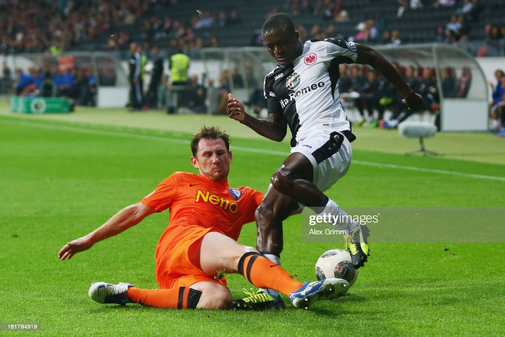 Constant Djakpa (R) of Frankfurt is challenged by Paul Freier of Bochum during the DFB Cup second round match between Eintracht Frankfurt and VfL Bochum at Commerzbank-Arena on September 25, 2013 in Frankfurt am Main, Germany.