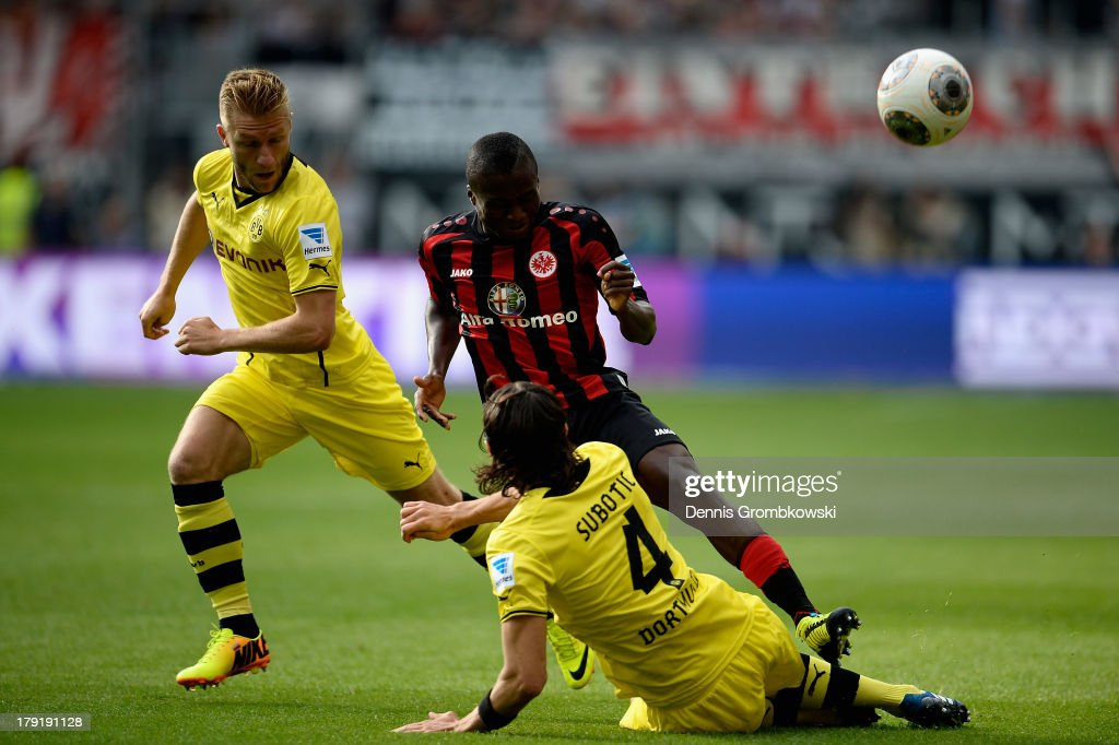 Constant Djapka of Eintracht Frankfurt is challenged by <a gi-track='captionPersonalityLinkClicked' href=/galleries/search?phrase=Jakub+Blaszczykowski&family=editorial&specificpeople=2290714 ng-click='$event.stopPropagation()'>Jakub Blaszczykowski</a> and <a gi-track='captionPersonalityLinkClicked' href=/galleries/search?phrase=Neven+Subotic&family=editorial&specificpeople=2234315 ng-click='$event.stopPropagation()'>Neven Subotic</a> of Borussia Dortmund during the Bundesliga match between Eintracht Frankfurt and Borussia Dortmund at Commerzbank Arena on September 1, 2013 in Frankfurt am Main, Germany.