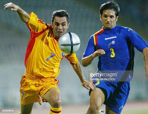 Petre Florentin from Romania fights for the ball along with Andorra's Escura Jordi during the first group qualifiyng match for 2006 FIFA World Cup in...