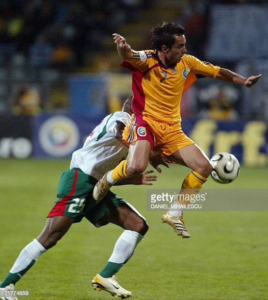 Romania's Florentin Petre vies for the ball along with Bulgaria's Wagner Lucio Freitas in the group G match of the EURO 2008 qualification in...