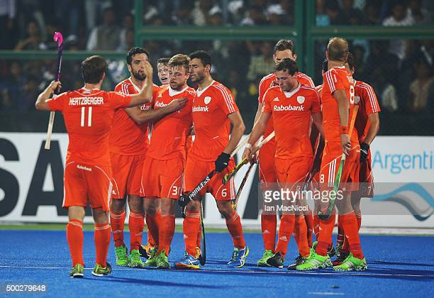 Constantijn Jonker of Netherlands last minute equaliser is celebrated during the match between Netherlands and India on day ten of The Hero Hockey...
