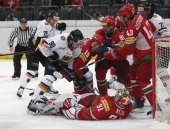 Constantin Braun of Germany and Dmitri Meleshko of Belarus fight for the puck during the international friendly match between Germany and Belarus at...