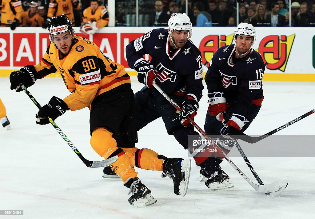 Constantin Braun of Germany Eric Nystrom and Ryan Potulny of USA compete for the puck during the IIHF World Championship group D match between USA...