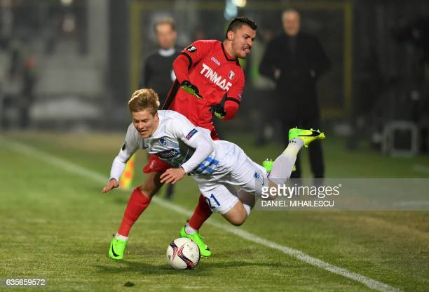 Constantin Budescu of Astra Giurgiu vies for the ball with Jere Uronen of KRC Genk during the UEFA Europa League round of 32 firstleg football match...