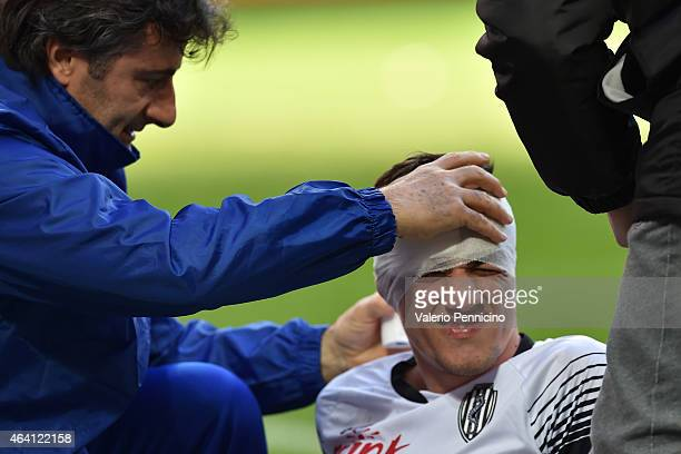 Constantin Nica of AC Cesena receives treatment for a head injury during the Serie A match between AC Milan and AC Cesena at Stadio Giuseppe Meazza...