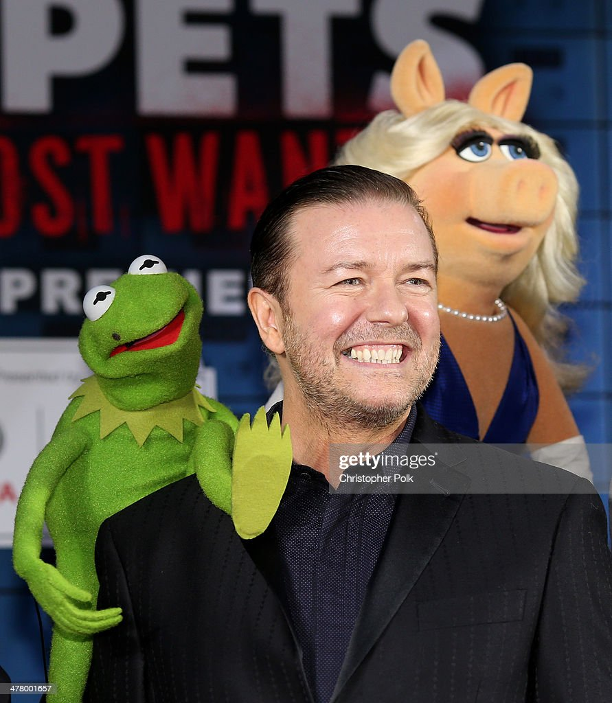 Constantine, actor <a gi-track='captionPersonalityLinkClicked' href=/galleries/search?phrase=Ricky+Gervais&family=editorial&specificpeople=209237 ng-click='$event.stopPropagation()'>Ricky Gervais</a> and Miss Piggy arrive at the world premiere of Disney's 'Muppets Most Wanted' at the El Capitan Theatre on March 11, 2014 in Hollywood, California.