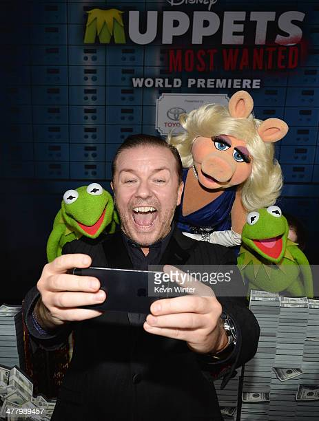 Constantine actor/comedian Ricky Gervias Miss Piggy and Kermit arrive for the premiere of Disney's 'Muppets Most Wanted' at the El Capitan Theatre on...