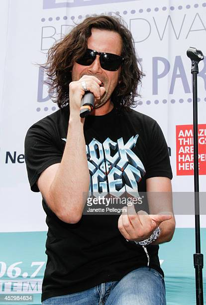 Constantine Maroulis from the cast of 'Rock of Ages' performs during 1067 LITE FM's Broadway in Bryant Park 2014 at Bryant Park on July 31 2014 in...