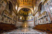 View of the interior of the basilica of San Giovanni in Laterano where you can see the decoration of the apse and the papal chair