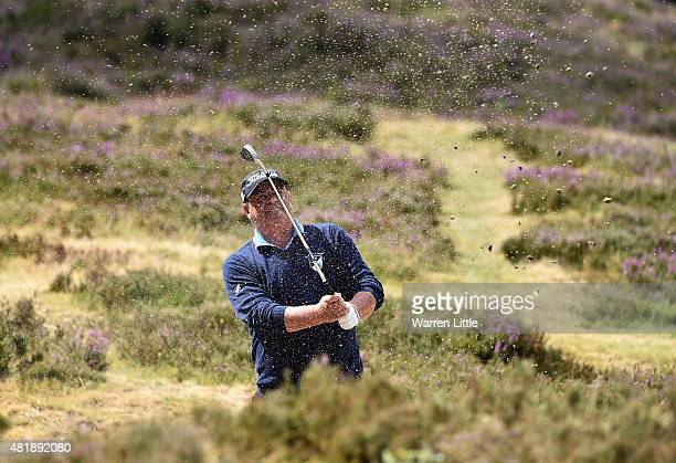 Constantino Rocca of Italy plays out of the 11th fairway bunker during completion of the second round of The Senior Open Championship on the Old...