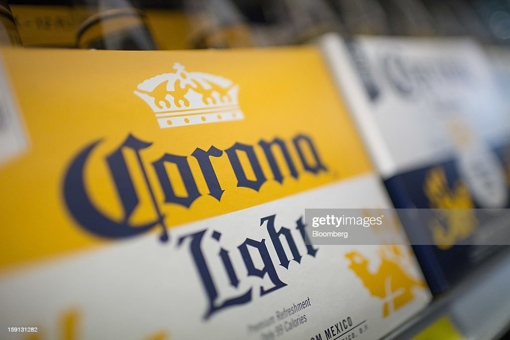 Constellation Brands Inc. Corona Extra is displayed for sale at a grocery store in New York, U.S., on Tuesday, Jan. 8, 2013. Constellation Brands Inc (STZ US) was rated new 'Buy' at ISI Group by equity analyst Robert Ottenstein. The 12-month target price is $43.00 per share. Photographer: Scott Eells/Bloomberg via Getty Images