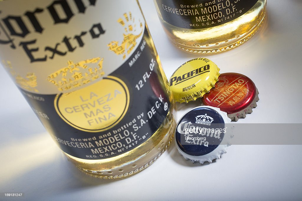 Constellation Brands Inc. Corona Extra, Tsingtao and Pacifico beer caps are arranged for a photograph in New York, U.S., on Tuesday, Jan. 8, 2013. Constellation Brands Inc (STZ US) was rated new 'Buy' at ISI Group by equity analyst Robert Ottenstein. The 12-month target price is $43.00 per share. Photographer: Scott Eells/Bloomberg via Getty Images